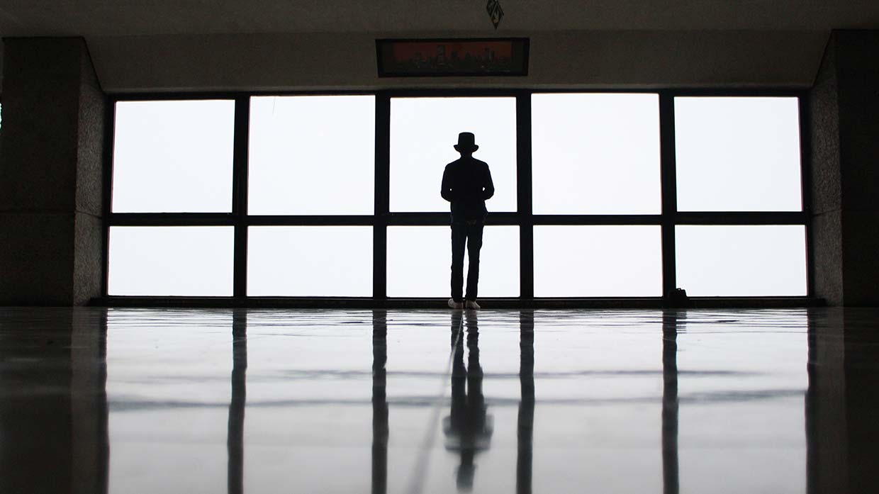 Man in top hat looking out of the window by Xopher Wallace